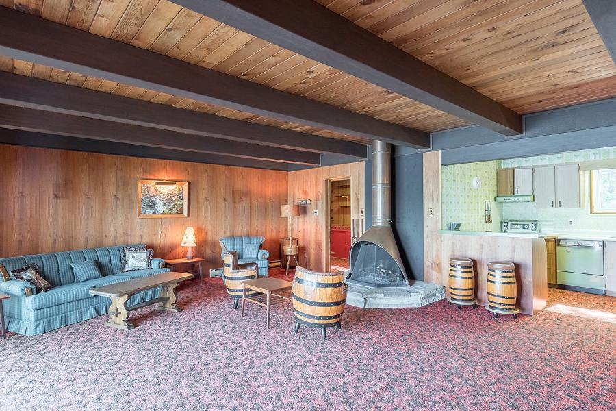 A copper acorn fireplace on the lower level is still in use. (Photo: Peterborough Fine Homes Photography)