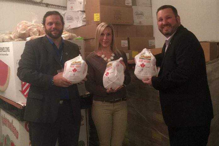 Ashlee Aitken of Kawartha Food Share with Barry McNair (left) and Bryan Buchanan (right) of Shorelines at Kawartha Downs (photo: Kawartha Food Share)