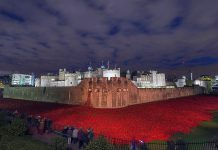 """""""Blood Swept Lands and Seas of Red"""" was a work of installation art placed in the moat of the Tower of London in England, between July and November 2014, to commemorate the centenary of the outbreak of World War I. It consisted of 888,246 ceramic red poppies, each intended to represent one British or Commonwealth serviceman killed in the War. The work's title was taken from the first line of a poem by an unknown World War I soldier. (Photo: Wikipedia)"""