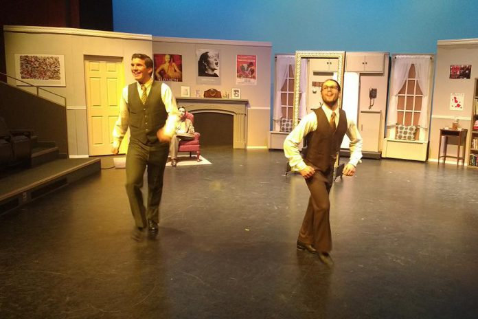 """Kristian Paschalis as Robert Martin and Liam Kaller as George, with Braeson Agar as The Man in the Chair in the background, during the dance highlight of the night """"Happy Feets"""" (photo: Sam Tweedle / kawarthaNOW)"""