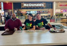 """Lansdowne Place has been recognized locally and nationally for its commitment to sustainability. Here the mall's security manager Keith Correia, marketing director Emily Dart, and operations manager Mario Serracino Place launch """"A Greener Way to Clean Your Tray"""" in the Lansdowne Place Food Court. (Photo courtesy of Lansdowne Place)"""