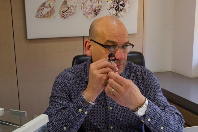 John examines a diamond in Antwerp. These diamonds are bought for clients in the Kawarthas. (Photo: Johnson's Jewellers)