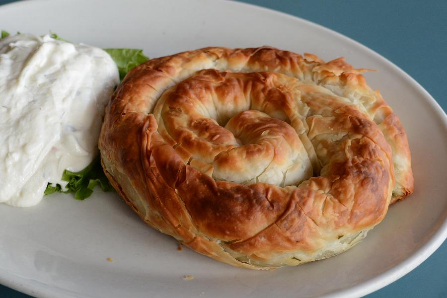 Spanakopita is Nicki's favourite dish, and it's served with a generous portion of tzatziki on the side. (Photo: Eva Fisher)