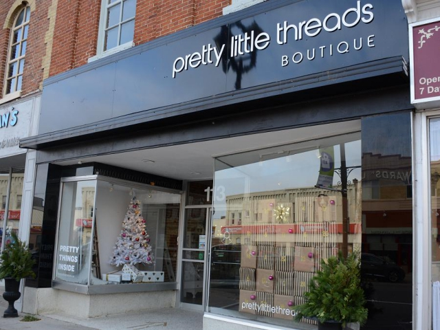 Be sure to check out the window displays as you enter Lindsay fashion boutique Pretty Little Threads. (Photo: Eva Fisher)