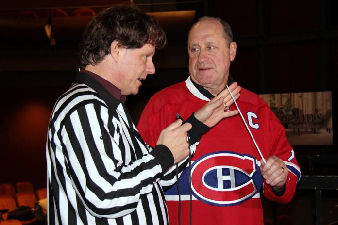 """Peterborough Symphony Orchestra music director and conductor Michael Newnham jokingly calls Bob Gainey on a """"baton penalty"""" at the Showplace Performance Centre stage"""