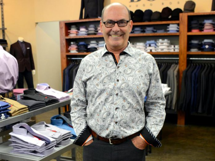 John Martin, owner of John Roberts Clothiers in downtown Peterborough, shows how to achieve an office-appropriate look with this Au Noir shirt. No tie is required, as the collar looks great unbuttoned. (Photo: Eva Fisher)