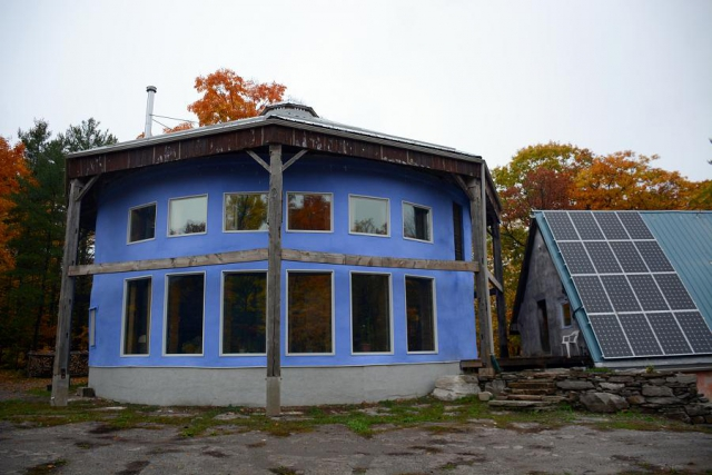 Sean Flanagan's large straw bale home is powered with a small solar array. Even with modern conveniences like a dishwasher, Sean only uses about 5 kWH per day. (Photo: Eva Fisher)