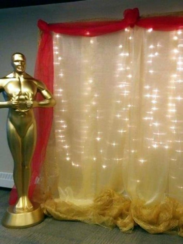 Century 21's Christmas party had an Oscars theme, complete with a red carpet and selfies with this Oscar statue. (Photo: Swanky Events)