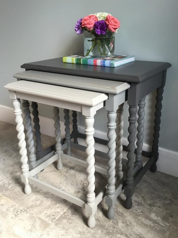 Nesting tables painted in tonal shades of grey creates a decor statement. (Photo: Style Your Nest)