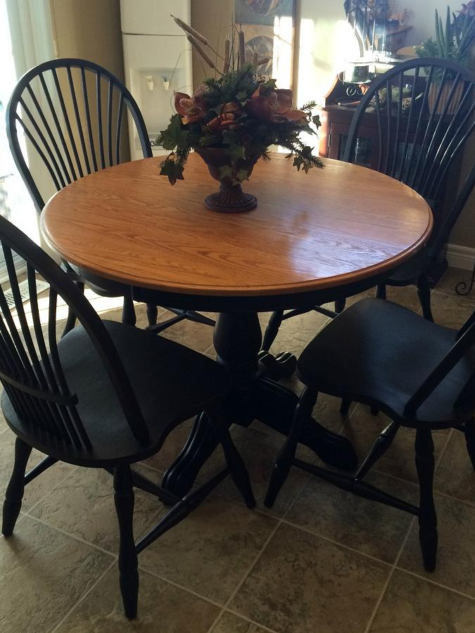 Jamie updated this wooden dining set with black paint, creating a high end look. (Photo: Style Your Nest)