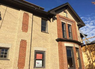 The bricks of the soon-to-open Publican House Restaurant in downtown Peterborough are being repainted by The Brick Painters (photo: Eva Fisher / kawarthaNOW)