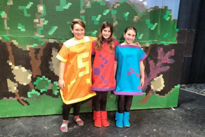 """Three of the young actors performing in """"The Reluctant Dragon"""" at Peterborough Theatre Guild (photo: Sam Tweedle / kawarthaNOW)"""