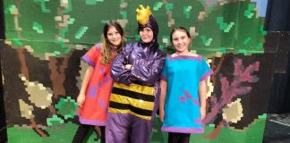 """Katherine Mason as Widget, Samuelle Weatherdon as Mortimer the Dragon, and Emily Keller as Hairytoes at a dress rehearsal for """"The Reluctant Dragon"""", the Peterborough Theatre Guild's annual holiday family play which opens on December 6 (photo: Sam Tweedle / kawarthaNOW)"""