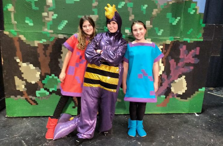 "Katherine Mason as Widget, Samuelle Weatherdon as Mortimer the Dragon, and Emily Keller as Hairytoes at a dress rehearsal for ""The Reluctant Dragon"", the Peterborough Theatre Guild's annual holiday family play which opens on December 6 (photo: Sam Tweedle / kawarthaNOW)"