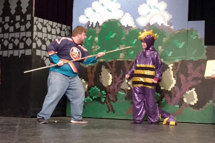 Josh Butcher as Saint George the Dragon Slayer, one of only three adult actors in the play, faces off against Samuelle Weatherdon as Mortimer during a dress rehearsal (photo: Sam Tweedle / kawarthaNOW)