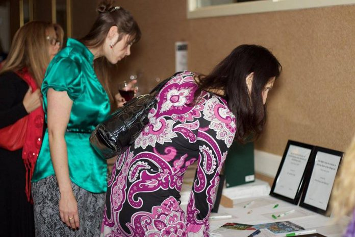 WBN members browse silent auction items at the 2015 Holiday Gala and Auction Fundraiser. For this year's gala, the organization has raised it fundraising goal to $20,000 in response to the urgent need in the community to support women and their children escaping situations of violence and abuse.