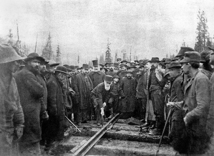 Donald Alexander Smith (Lord Strathcona) driving the last spike of the Canadian Pacific Railway at Craigellachie, British Columbia, on November 7, 1885, with Fleming standing behind him (photo: Wikipedia)