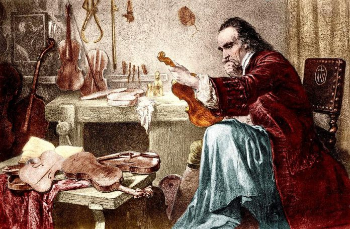 A romanticized print of Italian luthier Antonio Stradivari (1644-1737) examining an instrument. (Photo: Wikipedia)