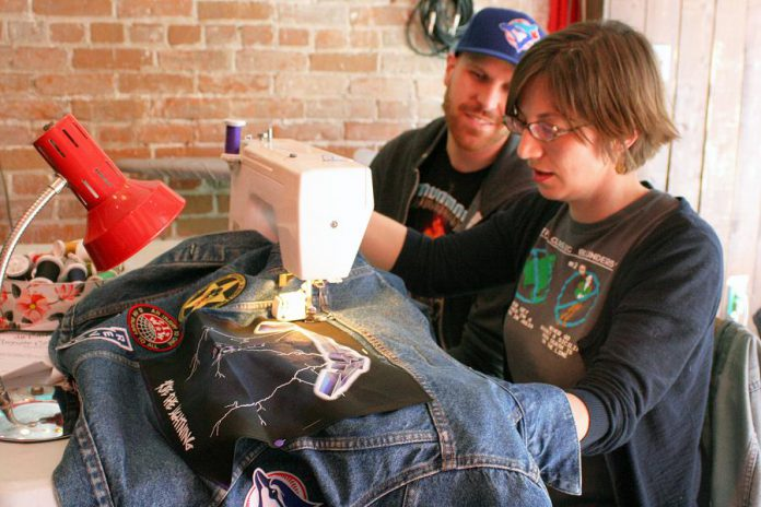 Volunteer fixer Kathryn Bahun helps an attendee of Repair Café Peterborough sew a patch on his jean jacket. Repair Café sewists can help you patch, stitch, and fix all sorts of clothing and apparel items, for free! Fixing rips and tears and updating with patches and custom embellishments helps clothing last longer, prevents un-necessary consumption of new items, and keeps clothes out of landfills.