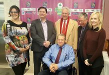 Inductee Mike Skinner (second from left) stands beside Peter Duffus (grandson of inductee JJ Duffus), with Junior Achievement's Marina Wilke (left), president and CEO John MCNutt (seated), board chair Paul Ayotte, and MaryBeth Miller (photo: Jeannine Taylor / kawarthaNOW)