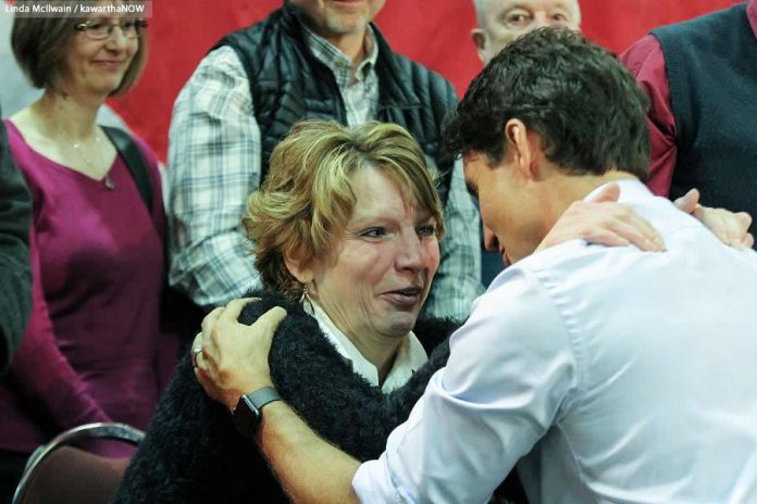 Prime Minister Justin Trudeau comforts an emotional Kathy Katula at the town hall in Peterborough. The single working mom from Buckhorn was upset about the high cost of hydro and the possibility of paying a carbon tax when she's already struggling to make ends meet. (Photo: Linda McIlwain / kawarthaNOW)
