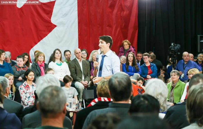 Prime Minister Trudeau addressing the crowd of 400 mostly pro-Liberal audience members at the Evinrude Centre in Peterborough  (photo: Linda McIlwain / kawarthaNOW)