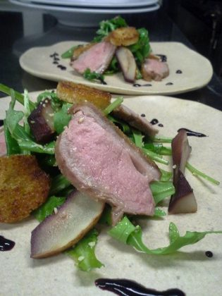 Chef Jay Nutt serves duck breast on fresh greens with poached pears, duck fat croutons, and blueberry gastrique at Mount Julian at Viamede Resort (photo: Jay Nutt)