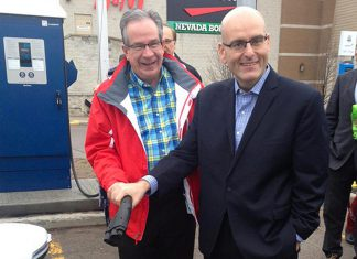 Peterborough MPP Jeaf Leal and Ontario Minister of Transportation Steven Del Duca demonstrate the electric vehicle charging station at Lansdowne Place Mall. The mall is one of seven locations in the City and County of Peterborough offering electric vehicle charging, which is free for the first year of operation. (Photo: Paul Rellinger / kawarthaNOW)