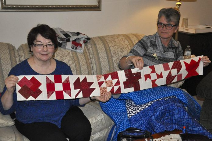 Colleen Carruthers and Debbie Fisico show off a row of the blocks that will make up the 150 Canadian Women quilt. Each block of the king-sized finished quilt is designated for a Canadian woman who has in some way been significant in the country's history.
