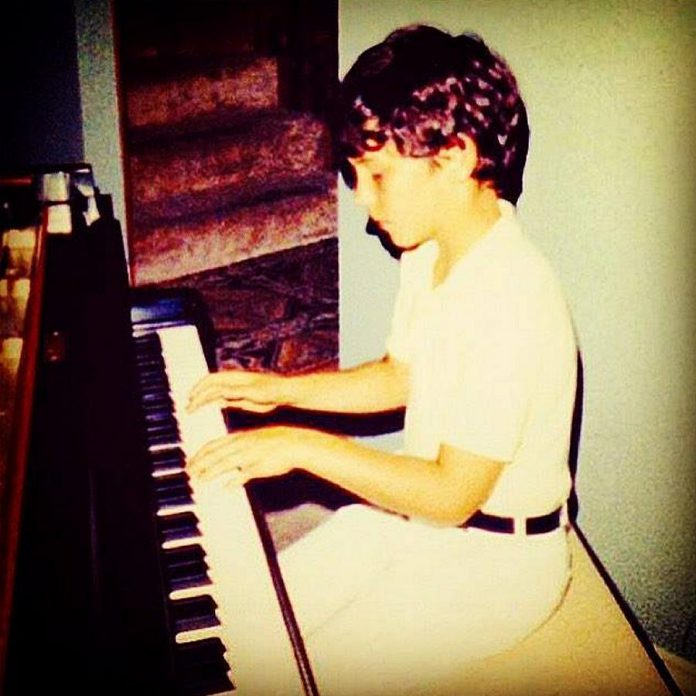A very young Royal Wood at the piano in his Lakefield family home. Named after his great grandfather Royal Rufus Wood (who was an avid amateur musician), Royal began playing piano by ear at the age of four and started lessons at age eight. (Photo: Royal Wood / Facebook)