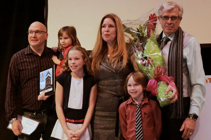 Tina Bromley with her husband Winston Bromley, left, and their children at the Win This Space contest finale on February 16 at The Venue in downtown Peterborough. Bromely won the competition which includes a free 12-month lease of a downtown Peterborough storefront for her business Tiny Greens. (Photo courtesy of Peterborough DBIA)