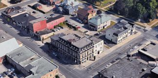 An aerial view of the Morrow Building at George and Brock streets in downtown Peterborough, with the two adjoining buildings housing the Black Horse Pub and the Pig's Ear Tavern. While the Morrow Building itself was designated as a heritage building in 1995, Peterborough City Council has decided not to approve heritage designation for the adjoining buildings, allowing them to be redeveloped by Parkview Homes. (Photo: Google)