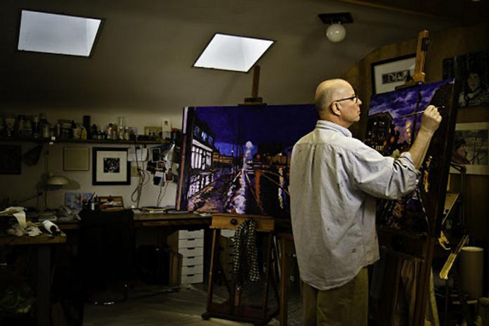 Painter Rob Neizen at work in his studio (photo courtesy of Mike Taylor)