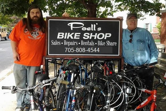 Patrick Poell with his dad Ed of Poell's Bike Shop, which recently moved to 366 George Street in downtown Peterborough