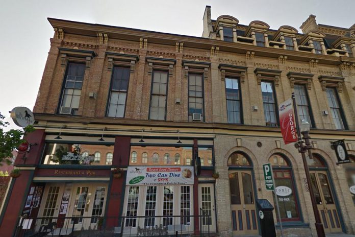 The building at 450 George Street North, currently housing The Black Horse Pub with apartments on the second floor, was built in 1882 in the same style as the adjoining Morrow Building (except for the roof). The Morrow Building itself received historic designation in 1995, but the designation does not include this adjoining building. The property is listed for sale with Century 21 and Parkview Homes has a conditional offer on it. (Photo: Google)