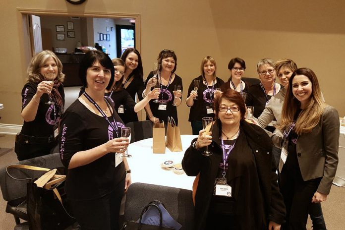 Some of the women who attended the Peterborough's first International Women's Day Conference, toasting the end of a successful day (photo: Jeannine Taylor / kawarthaNOW)