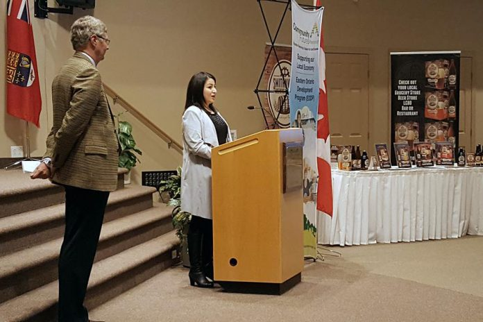 As Community Futures Peterborough member Gord James looks on, Peterborough-Kawartha MP Maryam Monsef speaks at a March 2nd showcase highlighting successes under the Eastern Ontario Development Program, a federal grant program to advance economic development in rural eastern Ontario. In the Peterborough area, Community Futures Peterborough administers the program that has benefited 557 organizations and businesses over the past 14 years. (Photo: Jeannine Taylor / kawarthaNOW)
