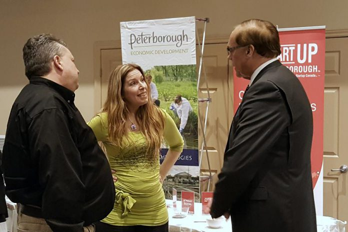 Tiny Greens owner Tina Bromley chats with Peterborough DBIA executive director Terry Guiel and Peterborough Mayor Darryl Bennett at a showcase celebrating successes under the Eastern Ontario Development Program (EODP). Bromely recently won a year-long lease for a downtown Peterborough storefront in the DBIA's Win This Space contest, which was supported with funding from the federal program administered by Community Futures Peterborough. (Photo: Jeannine Taylor / kawarthaNOW)