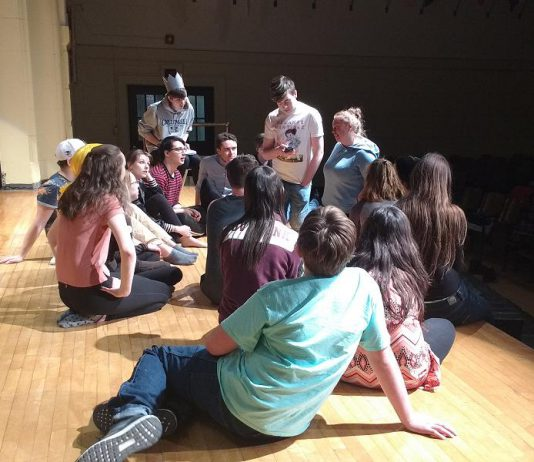 """Writer and director Jen Nugent speaks to the cast of Peterborough-area high school students during a rehearsal of """"Everybody Loves Archie"""", an original Enter Stage Right production running April 26 to 29 (photo: Sam Tweedle / kawarthaNOW)"""