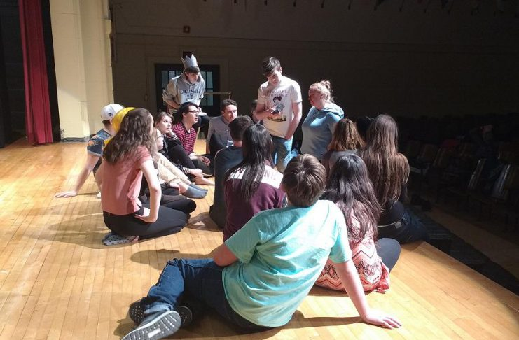 "Writer and director Jen Nugent speaks to the cast of Peterborough-area high school students during a rehearsal of ""Everybody Loves Archie"", an original Enter Stage Right production running April 26 to 29 (photo: Sam Tweedle / kawarthaNOW)"