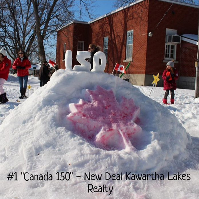"""Kelly James and Tom Wood of New Deal Realty won in the Business category for """"Canada's 150th""""."""