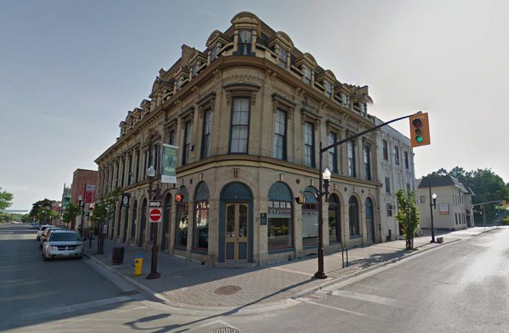 The Morrow Building at Brock and George streets in downtown Peterborough. Parkview Homes has purchased the property at 144 Brock Street (the white building at the right adjoining the Morrow Building) and has a conditional offer on the property at 450 George Street North (the building at the left adjoining the Morrow Building but with a different roof). Unlike the Morrow Building itself, neither adjoining property has been historically designated. (Photo: Google)
