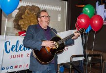 Musician Rick Fines, pictured at the March 30th announcement, is one of many local performers who will be entertaining revellers during Canada 150 celebrations in downtown Peterborough on June 29 and 30 (photo: Peterborough DBIA)