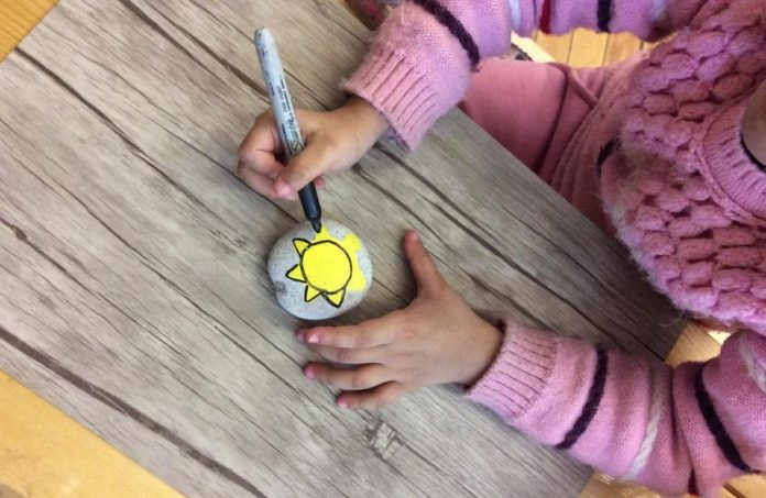 Senior Kindergarten and Grade 1 students, led by teacher Kim Meekin, have painted more than 150 rocks for their Spread the Sunshine project