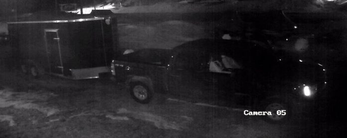 Suspects in this black pickup truck were captured on security footage towing an enclosed black trailer, one of several items of equipment stolen from Tucker's Marine in Apsley overnight on March 10