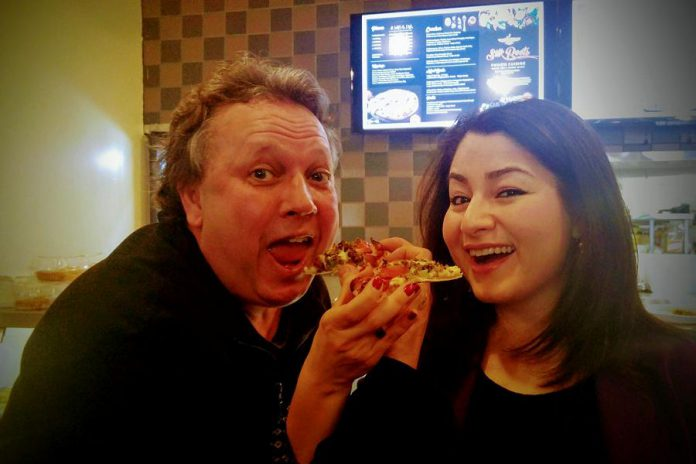 Peterborough's downtown continues to attract new businesses, thanks in part to Terry's efforts. Here he is with Peterborough-Kawartha MP Maryam Monsef enjoying a slice during last month's grand opening of Silk Roots Fusion Cuisine.
