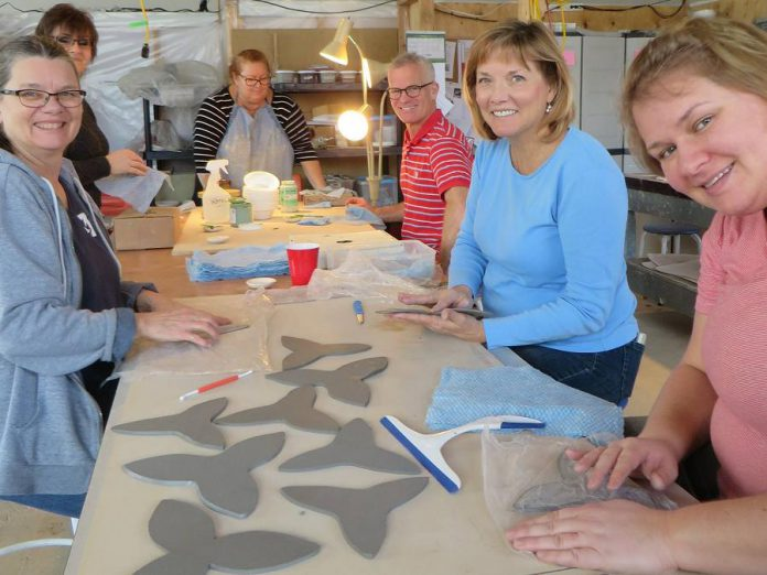 Some of the volunteers at the Kawartha Potters Guild who have created 600 ceramic trilliums for the Peterborough War Memorial (photo: Kawartha Potters Guild)