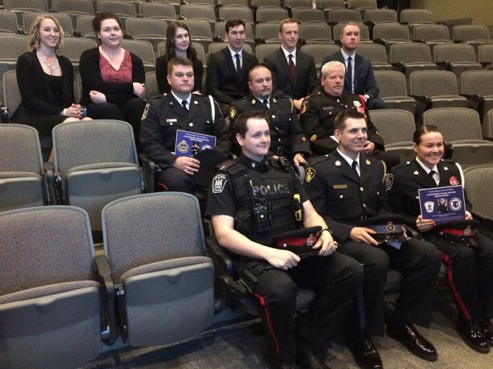The police officers who received the Outstanding Police Officer Service Award with the students from Fleming College's Police Foundations program who presented the awards (photo courtesy of Fleming College)