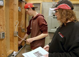 St. Stephen Catholic Secondary School student Zack Dingwall, 17, who is enrolled in the electrician course as part of the Ontario Youth Apprenticeship Program at Durham College, takes instruction from teacher Jeff Van Moosdyk at the Whitby Trade Centre.