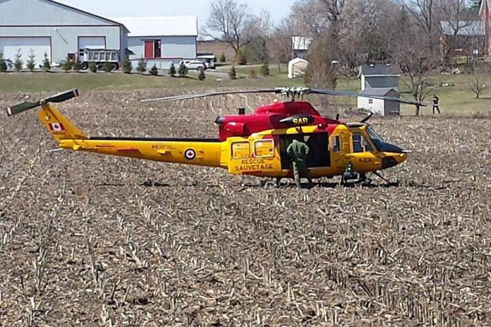 Gotta have that BBQ! This helicopter out of Canadian Forces Base Trenton landed in a farmer's field beside Muddy's Pit BBQ in Keene. (Photo: Neil Lorenzen)